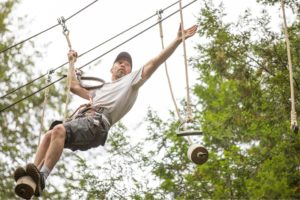 Fathers climb on adventure course